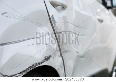 wheel and the door of the car after the accident.