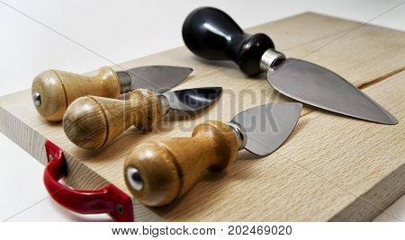 set of knives for italian typical parmiggiano reggiano cheese. for food concept
