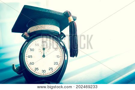 Time is Education Graduation cap on top clockConcept of educational times Studies lead to success in life Graduate study abroad program.