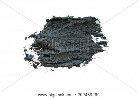 Black volcanic cosmetic clay in a bowl. cosmetic clay texture close up. solution of cosmetic clay abstract background