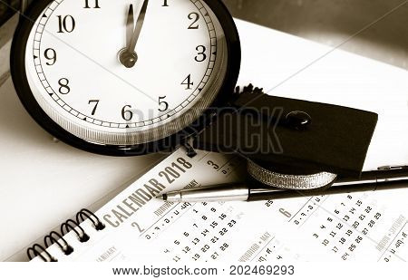 Graduation cap on Thai alphabet Calendar 2018 page background with time Clock Education international Concept Black and white tone