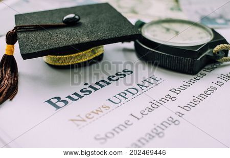 Time is Education Graduation cap and Clock on papers letter Business News Update Concept of educational times Studies lead to success in life Graduate study abroad program black and whith tone