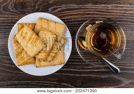 Cookies With Raisin In Plate And Cup Of Tea