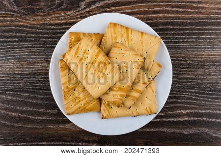 Cookies With Raisin In White Plate On Dark Wooden Table