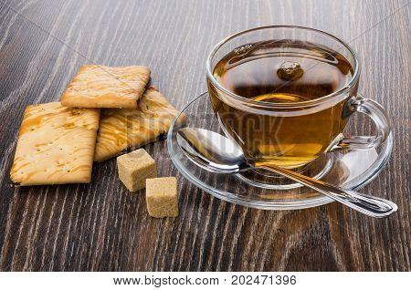 Cookies With Raisin, Cup Of Tea, Lumpy Sugar And Teaspoon