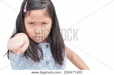 Closeup portrait angry mad child pointing finger at someone displeased isolated on white background. Human face expressions emotions feelings body language