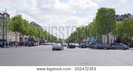 Paris; France- May 01; 2017: Champs Elysees. On the roadway moving cars pedestrians-on sidewalks