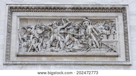 Paris; France- May 01; 2017: Triumphal arch on the Champs Elysees.Bas-relief symbolizing itself the capture of Napoleon Alexandria in 1798