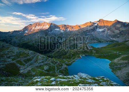 High Altitude Alpine Lake, Dams And Water Basins In Idyllic Land With Majestic Rocky Mountain Peaks