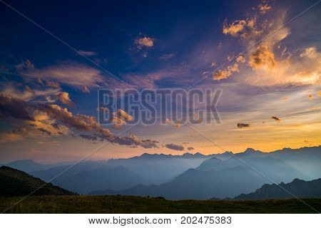 Colorful Sunlight On The Majestic Mountain Peaks, Green Pastures And Foggy Valleys Of The Italian Al
