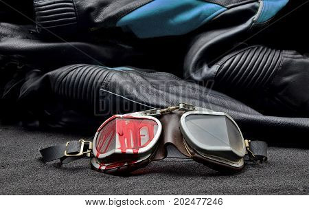 old Motorcycle glasses with blood and jacket behind