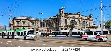 Zurich, Switzerland - 18 June, 2017: the building of the Zurich main railway station, traffic in front of it. Zurich main railway station is the largest railway station in Switzerland and one of the busiest railway stations in the world.