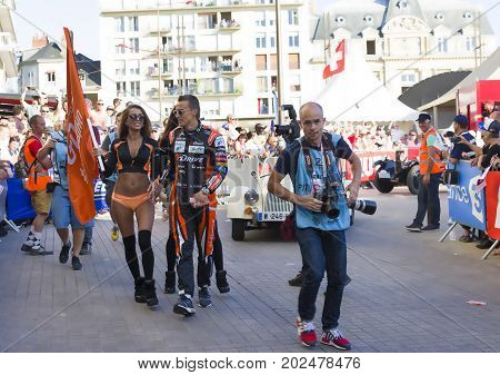 LE MANS FRANCE - JUNE 16 2017: Roman Rusinov russian race car driver G-Drive Racing with girls on a parade of pilots racing