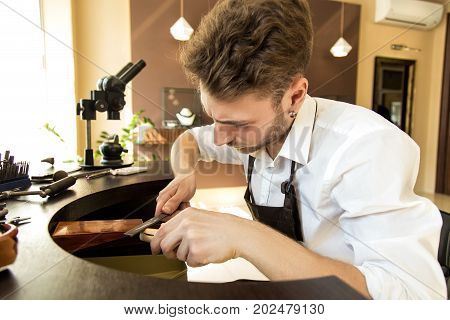 Male Jeweler Is Working On Making A Ring