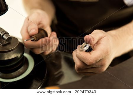 The Process Of Creating And Polishing A Ring Close-up