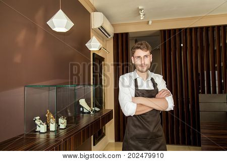 A Man In A Jewelry Store Before The Manufacture