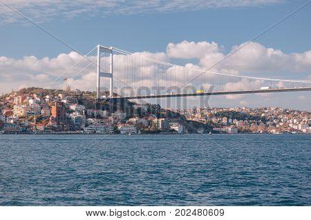 Istanbul, Turkey.  View of the Fatih Sultan Mehmet Bridge and residental buildings sailing Bosporus.