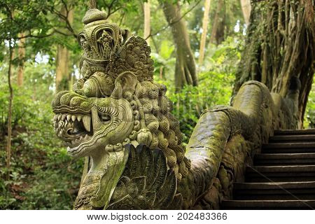 Balinese stone statue before a temple. Bali