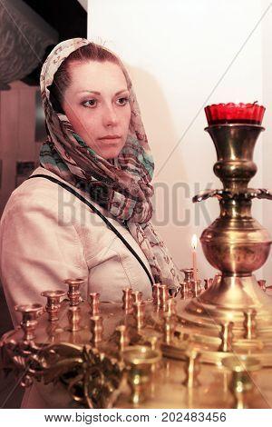 A woman prays in the Russian church
