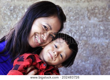 Young happy asian mother and her son