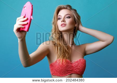 Beautiful Young Blonde Woman Posing In Studio In Swimsuit And With Phone