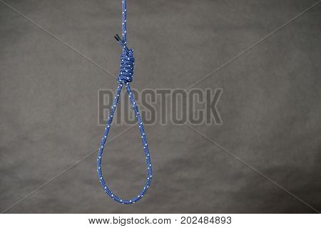 Suicide rope with knot on black background. Sorrow psychological problems objects concept.