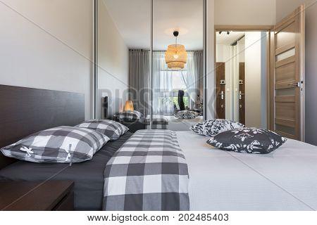Modern bedroom interior design in wooden finish