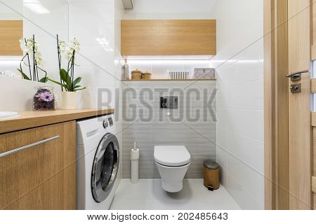 Modern bathroom interior design in wooden and gray finish