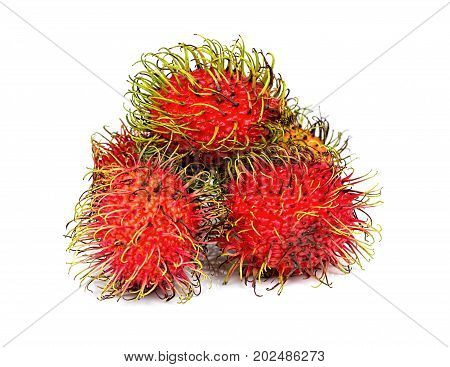 Ripe red rambutans isolated on white background