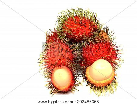 Ripe rambutan fruits isolated red partly cut