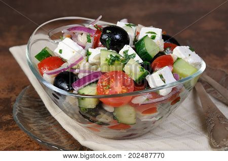 greek salad orzo pasta with black olive red onion and cucumber cherry tomatoes feta and herbs