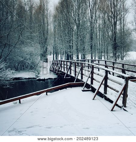 Wooden Bridge Covered With Snow. Winter Day.