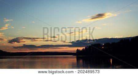 Sunset On The Lake. Calm Summer Evening. Kenozero.