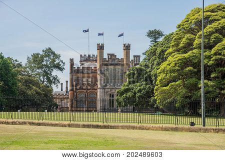 SYDNEY,NSW,AUSTRALIA-NOVEMBER 20,2016:  Governor's House with Australian Flags and tourists in Sydney, Australia