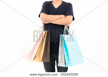 Young confident attractive Asian blue shirt man with shopping bags standing with portrait on white background. For shopping sale business young teen boy season shopper visual communication design