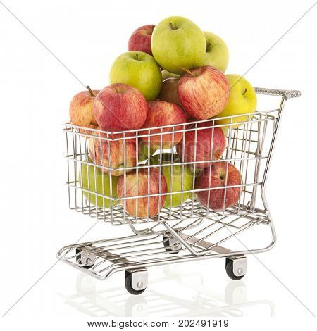 Green and red apples in shopping cart isolated over white background