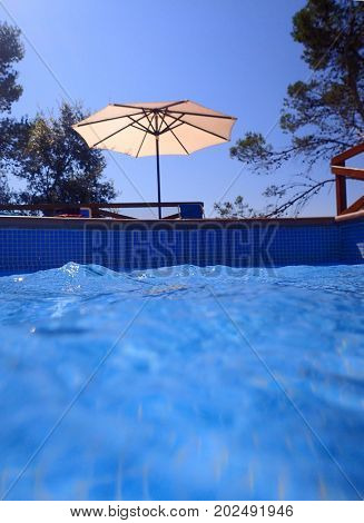 Swimming pool with water and parasol