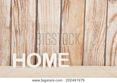 Word home on wooden background