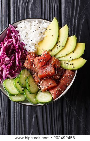 Hawaiian Tuna Poke Bowl With Avocado, Red Cabbage, Cucumber And Sesame Seeds. Vertical Top View