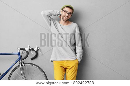 People, Travel, Leisure And Lifestyle Concept. Smiling Young Hipster Man In Fashionable Clothes Stan
