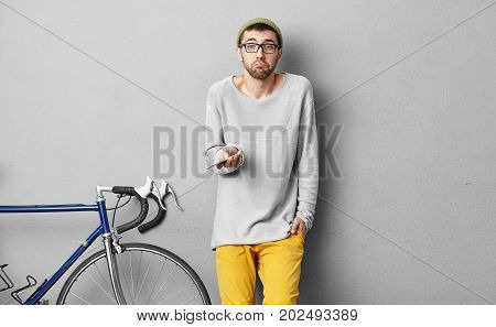 Portrait Of Young Male Traveller, Having Cycle Race, Holding Modern Smart Phone In Hands, Using Navi