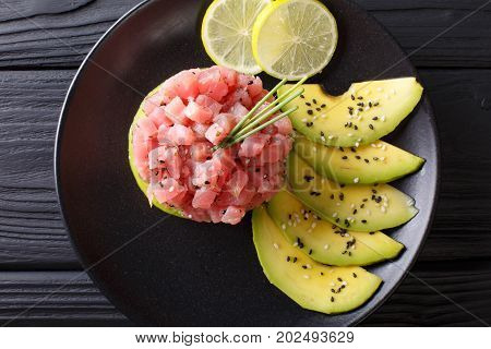 Tartar From Tuna Served With Avocado And Lime Macro. Horizontal Top View