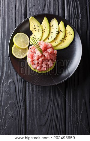 Beautiful Food: Fresh Tuna Tartar With Lime, Avocado And Sesame Close-up. Vertical Top View