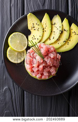 Tartare Of Fresh Raw Tuna With Spices Close-up. Vertical Top View
