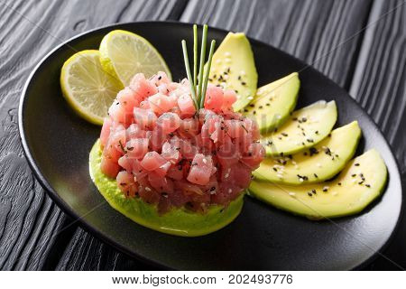 Tartar Of Fresh Tuna With Spices, Lime And Sesame Close-up. Horizontal