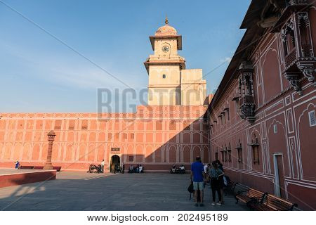 JAIPUR RAJASTHAN INDIA - MARCH 10 2016: Horizontal picture of clock tower with painted wall inside of City Palace in Jaipur known as pink city of Rajasthan in India.