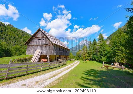 Mountain farm house, hut in European Alps, located in Robanov kot, Slovenia, popular hiking and climbing place with picturescue view