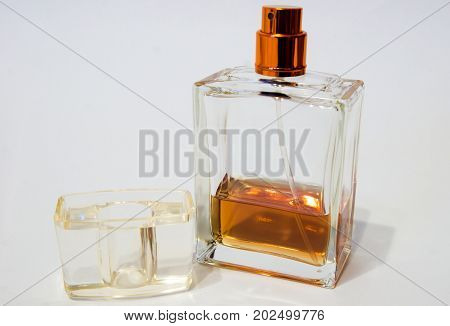 Men's Cologne. Men's Cologne on a white background. Cologne the color of cognac.