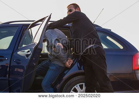 Arresting A Thief, A Criminal, A Drug Dealer With Hands Armed With Police Cuffs, A Thief Disabled, T