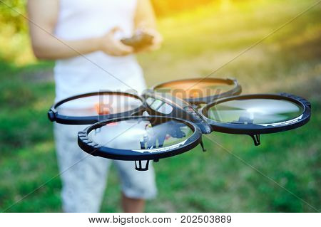 Remote controle of drone. Drone flying outdoor